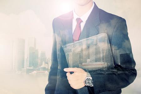 Photo pour Conceptual image of urban lifestyle. Double exposure of businessman body in suit and modern city horizon - image libre de droit