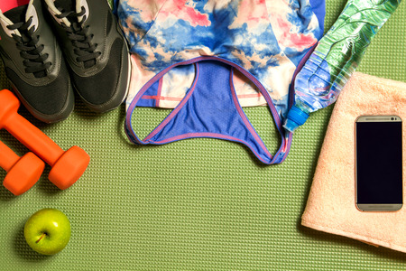 A set of sports equipment on the mat. top view