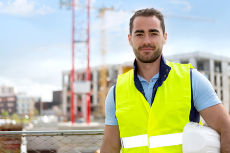 Photo pour View of an attractive worker on a construction site - image libre de droit