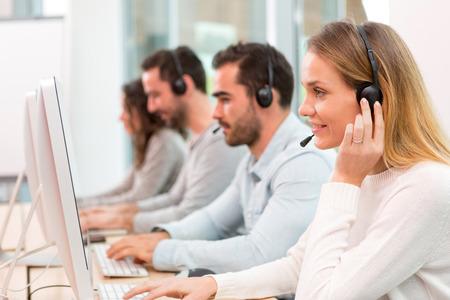 Foto de View of a Young attractive woman working in a call center - Imagen libre de derechos