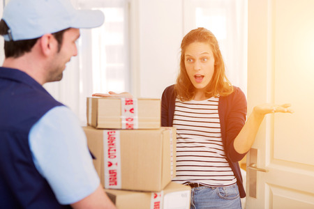 Photo pour View of a Delivery man handing over a parcel to customer - image libre de droit