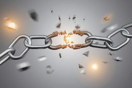 Foto de View of a Weak link of a Broken chain exploding - 3d render - Imagen libre de derechos