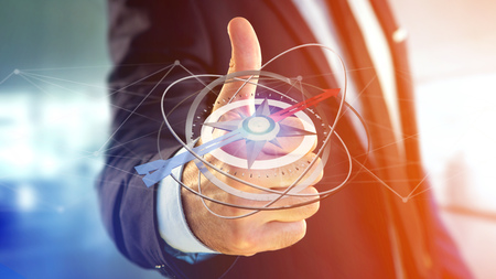 View of a Business man holding a navigation compass - 3d rendered
