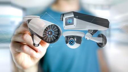 Foto de View of a Businessman holding a Security camera system and network connection - 3d rendering - Imagen libre de derechos