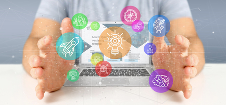 Photo for View of a Businessman holding a Cloud of colorfull start up icon bubble with a laptop 3d rendering - Royalty Free Image