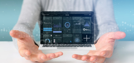 Foto de View of Businessman holding Laptop with business user interface data on the screen - Imagen libre de derechos