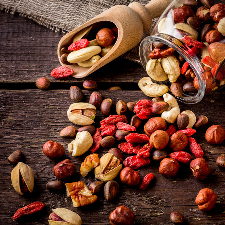 Photo for Scatterede nuts  and shovel. Wooden background,selective focus. - Royalty Free Image