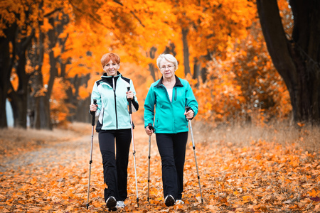 Foto per Mother and daughter train nordic walking - Immagine Royalty Free