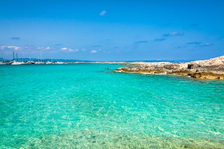 Foto de Tourists in Illetes beach Formentera island, Mediterranean sea, Spain - Imagen libre de derechos