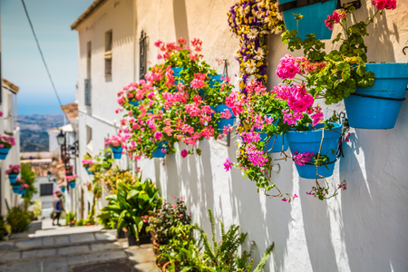 Photo pour Picturesque street of Mijas with flower pots in facades. Andalusian white village. Costa del Sol. Southern Spain - image libre de droit