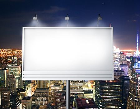 Foto de Billboard with empty screen, against modern city - Imagen libre de derechos