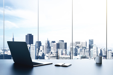 Photo for modern office with laptop and view to city - Royalty Free Image