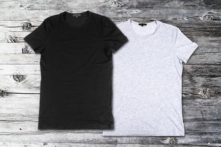 Photo pour blank t-shirts on the wooden background - image libre de droit