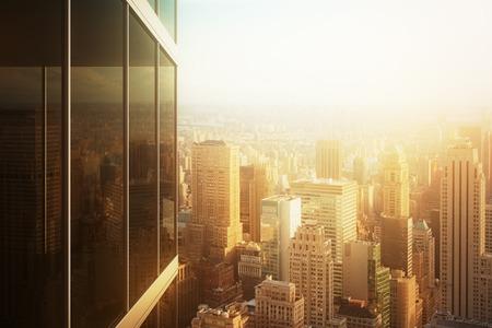Foto de Cityscape reflected in the glass of an office building at sunset - Imagen libre de derechos