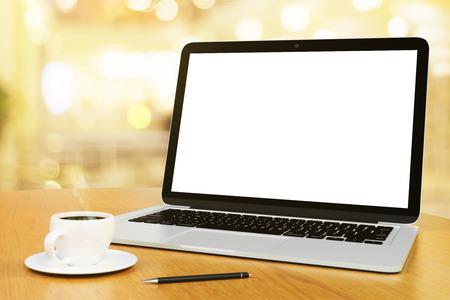 Foto de blank screen of laptop with cup of coffee and pen, mock up - Imagen libre de derechos