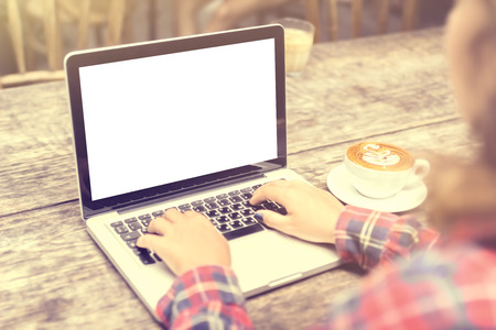 Photo for girl with a cup of coffee and a blank laptop, mock up - Royalty Free Image
