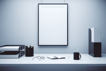 Photo pour Blank picture frame on a wall and table with glasses, diary and coffee mug, mock up - image libre de droit
