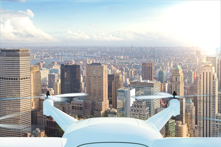 Foto de Drone delivers the goods against the background of New York at sunset - Imagen libre de derechos