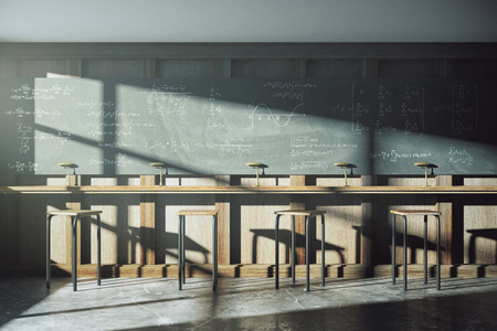 Photo pour Vintage university classroom with equation solution on blackboard - image libre de droit