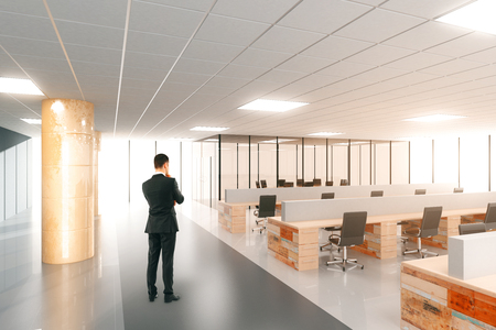 Photo for Businessman in modern open space office with furniture - Royalty Free Image