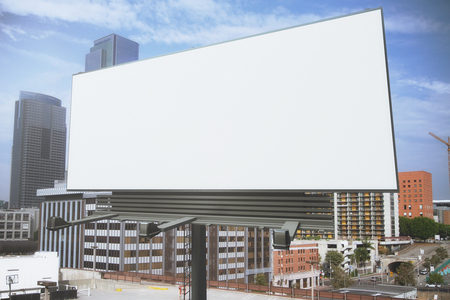 Foto de Blank white billboard on a background of buildings, mock up - Imagen libre de derechos