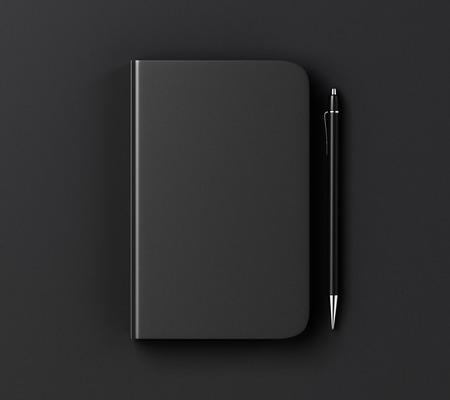Photo pour Blank black diary cover and pen on black table, mock up - image libre de droit