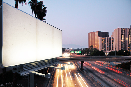 Photo pour Blank white billboard on the background of the highway at evening, mock up - image libre de droit