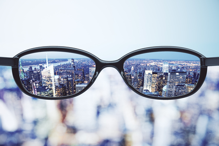 Foto de Clear vision concept with eyeglasses and night megapolis city background - Imagen libre de derechos