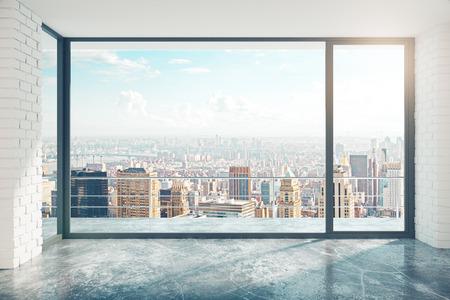 Foto de Empty loft style room with concrete floor and city view - Imagen libre de derechos