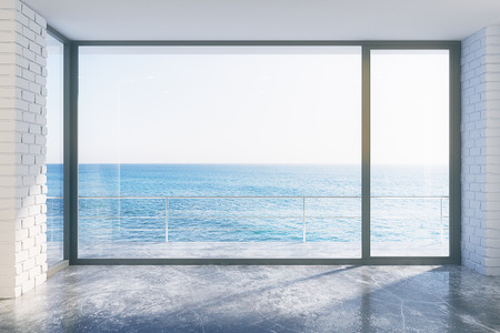 Foto de Empty loft style with concrete floor and ocean view - Imagen libre de derechos