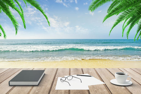 Foto de Diary, blank papers and cup of coffee on wooden bench at beach background - Imagen libre de derechos