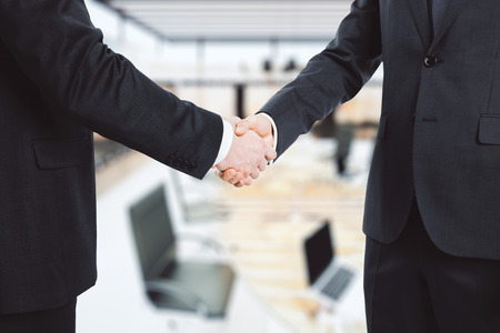 Photo for Business partners shake hands in the office - Royalty Free Image