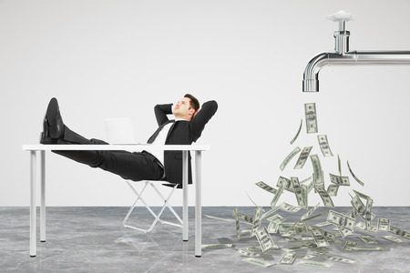 Photo for Businessman resting on a chair and faucet from which the money flow - Royalty Free Image