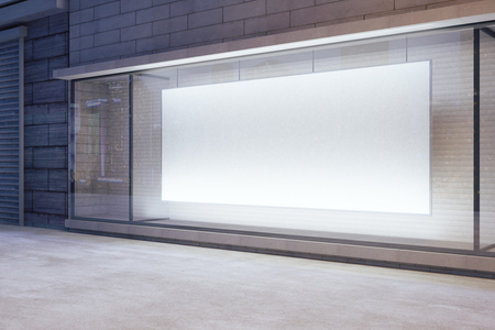 Photo pour Large blank banner in a shop window at night, mock up - image libre de droit