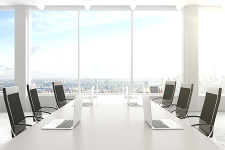 Foto de Modern conference room with furniture, laptops, big windows and city view - Imagen libre de derechos