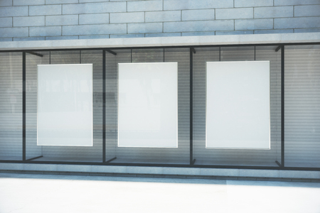 Photo for Blank white posters in glassy showcase on the street, mock up - Royalty Free Image