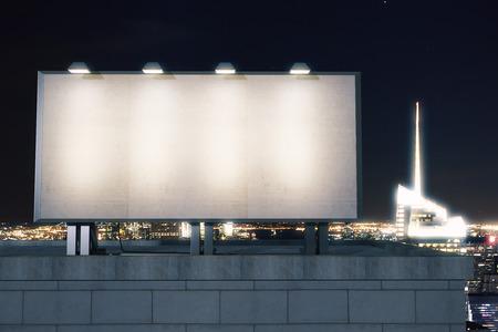 Foto de Big empty billboard on the background of the city at night, mock up - Imagen libre de derechos
