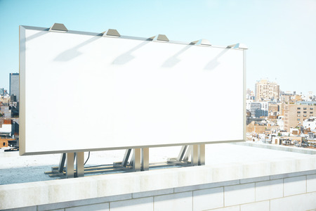 Foto de Blank billboard on the roof of building at megapolis city background, mock up - Imagen libre de derechos