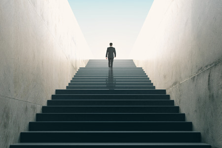 Photo pour Ambitions concept with businessman climbing stairs - image libre de droit