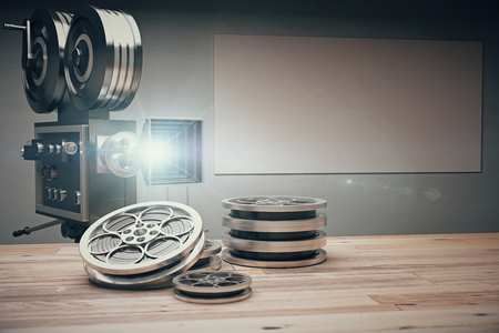 Photo for Vintage movie camera with Old style cassettes and film on wooden table - Royalty Free Image