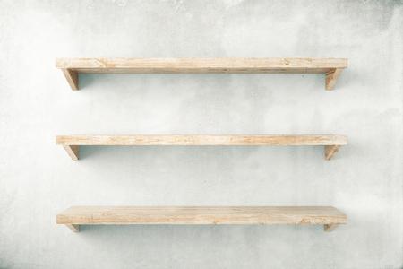 Foto de Empty shelves on concrete wall background. Mock up, 3D Render - Imagen libre de derechos