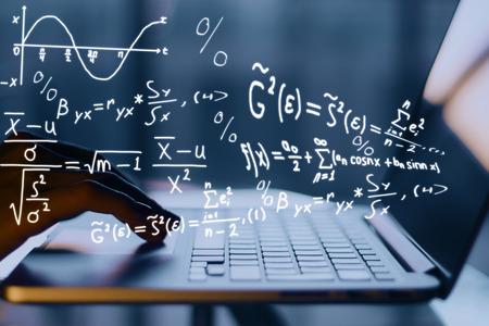 Foto de Hands using laptop with mathematical formulas. Online education concept - Imagen libre de derechos
