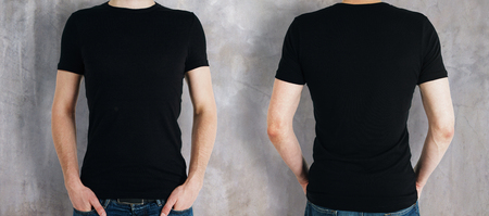Photo pour Man wearing empty black shirt on concrete background. Front and rear view. Shopping concept. Mock up - image libre de droit