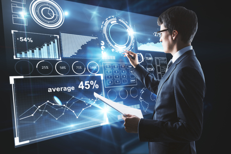 Foto de Young businessman with document in hand drawing something on abstract business chart display. 3D Rendering - Imagen libre de derechos