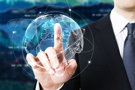 Foto de Businessman pointing at digital globe on forex background. Fund management concept. 3D Rendering - Imagen libre de derechos