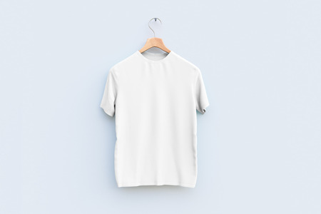 Photo pour Hanger with empty white t-shirt hanging on wooden wall. Ad concept - image libre de droit