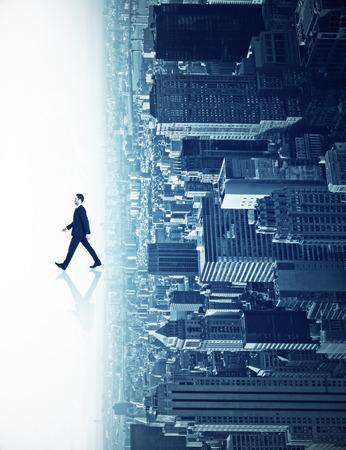 Foto de Walking businessman with shadow on abstract sideways city background. Forward concept - Imagen libre de derechos