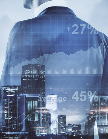 Foto de Unrecognizable businessman on abstract city background with business chart. Financial growth concept. Double exposure - Imagen libre de derechos