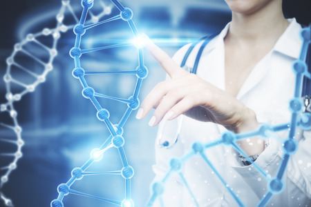 Foto de Female doctor pointing at abstract DNA hologram on blurry background. Science concept - Imagen libre de derechos
