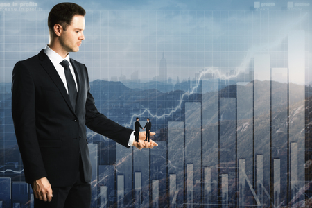 Side view of european businessman holding two tiny subordinated shaking hands on abstract city with business chart background. Teamwork and finance concept. Double exposure